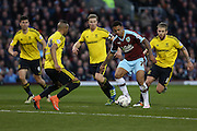 Andre Gray of Burnley is surrounded by Middlesbrough players on the edge of the box during the Sky Bet Championship match between Burnley and Middlesbrough at Turf Moor, Burnley, England on 19 April 2016. Photo by Simon Brady.