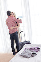 Young couple hugging in hotel room