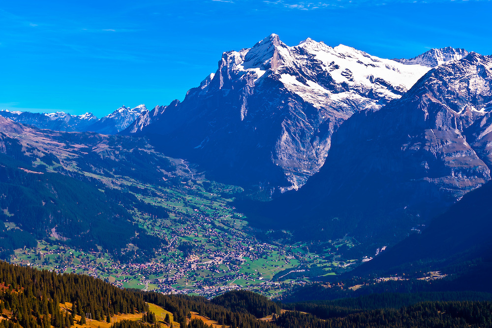Looking down from Mannlichen to Grindelwald, Swiss Alps, with the Eiger and Monch in the background, Canton Bern, Switzerland