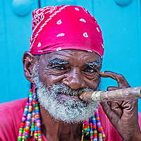 HAVANA, CUBA - JULY 18 : A portrait of a Cuban man smoking cigar in old Havana street on July 18 2016. Cuba now exports more than 90 million cigars a year