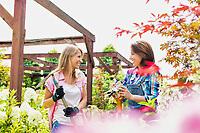 Portrait of beautiful gardeners walking while talking