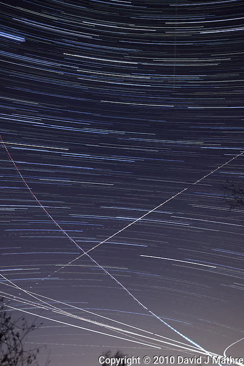 Late Fall Night Sky Image of Star and Jet Trails. Image taken with a Nikon D3x and 24 mm f/3.5 PC-E lens (ISO 400, f/4.0, 30 sec). Composite of 120 images over 1 hour combined with Startrails program. Hour 1.