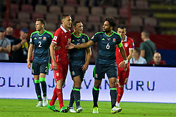 BELGRADE, SERBIA - Sunday, June 11, 2017: Wales' captain Ashley Williams and James Chester with Serbia's Namanja Matic during the 2018 FIFA World Cup Qualifying Group D match between Wales and Serbia at the Red Star Stadium. (Pic by David Rawcliffe/Propaganda)