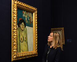 "Sotheby's, Mayfair, London, October 9th 2015. Expected to fetch up to $60,000,000 at auction, Sotheby's presents ""the finest Blue Period Picasso to come to market in a generation"", painted in 1901 when Pablo Picasso was just shy of 20 years old. PICTURED: A Sotheby's representative admires the Picasso ahead on its auction in New York. // Contact: paul@pauldaveycreative.co.uk Mobile 07966 016 296"