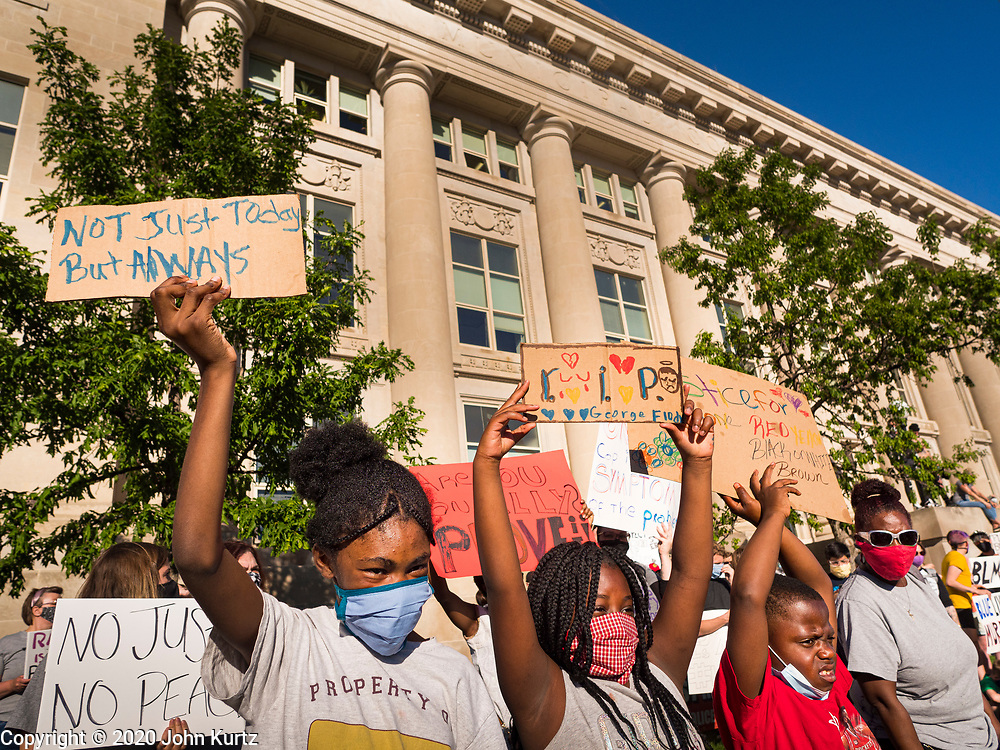 29 MAY 2020 - DES MOINES, IOWA: African-American children at a vigil for George Floyd in front of the Des Moines Police station Friday evening. About 1,000 people attended the vigil. Floyd, a 46 year old unarmed African-American man, was killed by four Minneapolis police officers Monday evening May 25. The four police officers were fired from the Minneapolis Police Department. Officer Derek Chauvin, seen in videos with his knee on Floyd's neck, was charged with third-degree murder and second-degree manslaughter on Friday in Floyd's death. The death of George Floyd, while he was restrained and in police custody, has set off protests and vigils across the US.        PHOTO BY JACK KURTZ