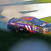 Denny Hamlin (11) spins on the grass after winning the 58th Annual NASCAR Daytona 500 auto race at Daytona International Speedway on Sunday, February 21, 2016 in Daytona Beach, Florida.  (Alex Menendez via AP)