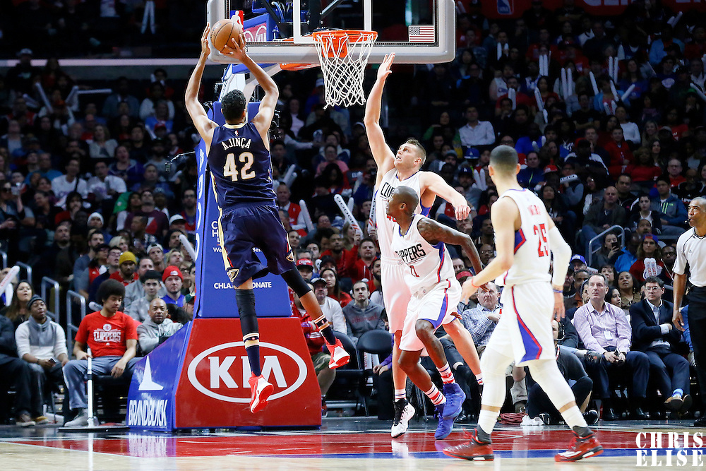 10 January 2016: New Orleans Pelicans center Alexis Ajinca (42) takes a jump shot over Los Angeles Clippers center Cole Aldrich (45) during the Los Angeles Clippers 114-111 overtime victory over the New Orleans Pelicans, at the Staples Center, Los Angeles, California, USA.