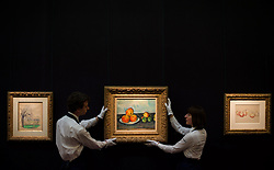 © Licensed to London News Pictures. 12/04/2013. London, UK. Gallery assistants mount Paul Cézanne's 'Les Pommes.' painting with an estimated value of between 25 - 35 million USD for the upcoming New York auctions. Highlights from Sotheby's New York auctions of Impressionist and Modern Art and Contemporary Art will be exhibited to the public from 12-16 April at  Sotheby's London New Bond Street galleries..Photo credit : Peter Kollanyi/LNP