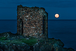 The moon rises above Lady's Tower in Elie, Fife. The structure was built in 1760 for Lady Janet Anstruther to use as a changing room prior to her morning bathing routine.