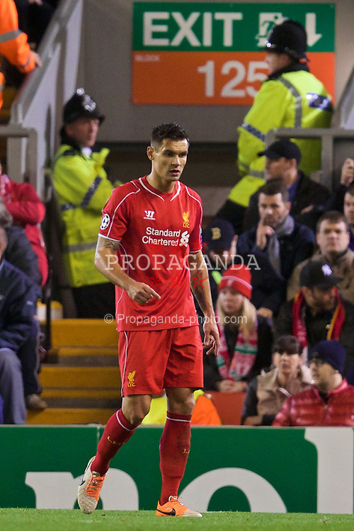 LIVERPOOL, ENGLAND - Wednesday, October 22, 2014: Heading for the exit... Liverpool's Dejan Lovren in action against Real Madrid CF during the UEFA Champions League Group B match at Anfield. (Pic by David Rawcliffe/Propaganda)