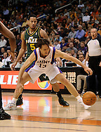 Mar. 14, 2012; Phoenix, AZ, USA; Phoenix Suns guard Steve Nash (13) reaches for the loose ball while playing against the Utah Jazz guard Devin Harris (5) during the first half at the US Airways Center. Mandatory Credit: Jennifer Stewart-US PRESSWIRE..