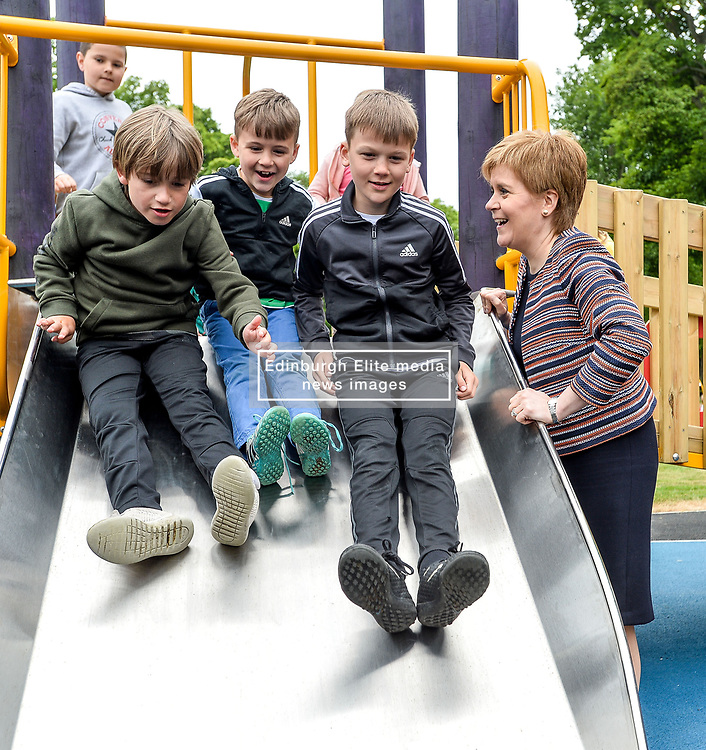 Pictured: Nicola Sturgeon meets children on one of the slides.<br /> <br /> First Minister Nicola Sturgeon opened Scotland's largest 'inclusive' play park at Pittencrief Park in Dunfermline.<br /> <br /> © Dave Johnston/ EEm