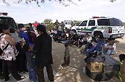 U.S. Border Patrol agents detain undocumented migrants near Sells, Arizona, on the Tohono O'odham Nation, USA.