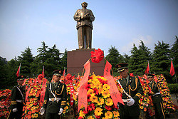 A picture made available on 12 May 2016 of People's Liberation Army (PLA) soldiers placing flower wreaths in front of Mao Zedong's giant statue on Mao Zedong Bronze Statue Square in Shaoshan, Hunan Province in central China, 28 April 2016. Shaoshan is the hometown of former Communist leader Mao Zedong, popularly known as Chairman Mao. As the fiftieth anniversary of the Cultural Revolution quietly approaches on 16 May, there is scant mention of the revolution where millions of intellectuals were persecuted and tortured in a bid to purge his critics in his this small town where he was hailed as a great hero and leader.