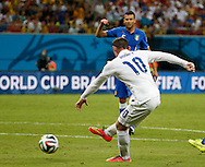 Wayne Rooney of England shoots wide during the 2014 FIFA World Cup match at Arena da Amazonia, Manaus<br /> Picture by Andrew Tobin/Focus Images Ltd +44 7710 761829<br /> 14/06/2014