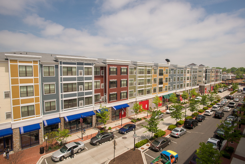 Urban renewal showing shopping, town homes, and cars at Rhode Island Row in Washington DC, USA