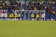 The away fans erupt as Antoni Sarcevic slots one away from the penalty spot during the Sky Bet League 1 match between Bury and Fleetwood Town at Gigg Lane, Bury, England on 18 August 2015. Photo by Mark Pollitt.