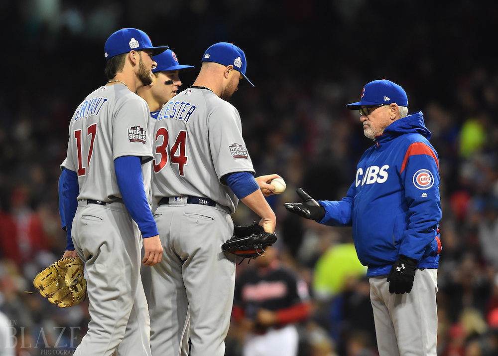 Oct 25, 2016; Cleveland, OH, USA; Chicago Cubs manager Joe Maddon (right) takes the ball from starting pitcher Jon Lester (34) in the sixth inning against the Cleveland Indians in game one of the 2016 World Series at Progressive Field. Mandatory Credit: Ken Blaze-USA TODAY Sports