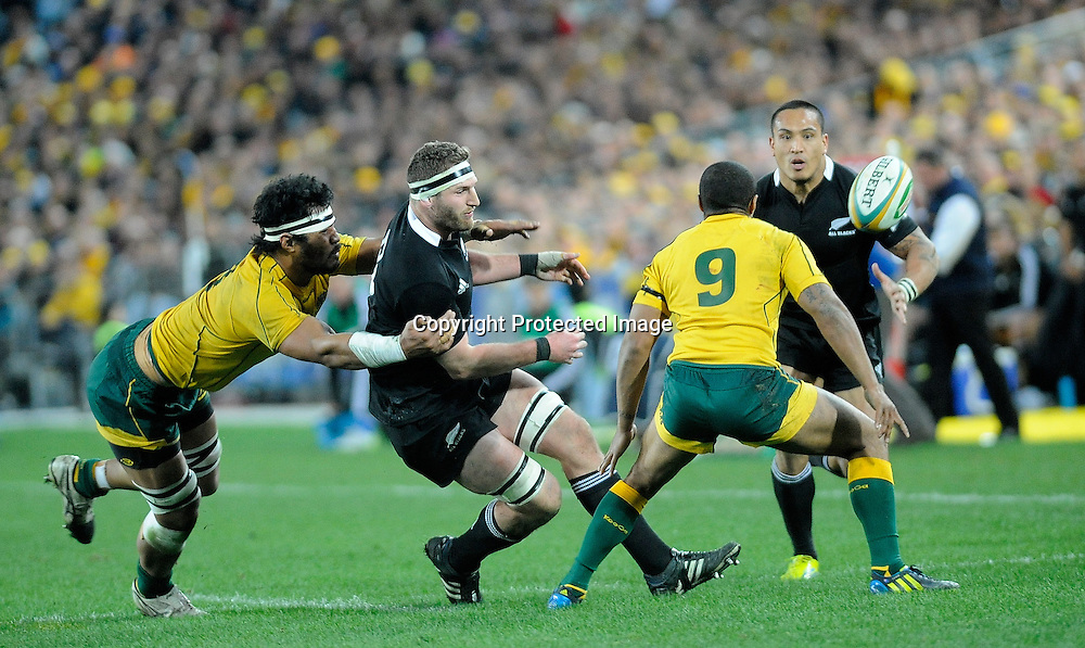 Kieran Read offloads to Hosea Gear, Rugby Championship. Australia v All Blacks at ANZ Stadium, Sydney, New Zealand. Saturday 18 August 2012. New Zealand. Photo: Richard Hood/photosport.co.nz