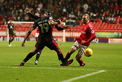 Charlton Athletics Ricky Holmes (right) is fouled by  Milton Keynes Dons Ethan Ebanks-Landell during the Sky Bet League One match at The Valley, Charlton.