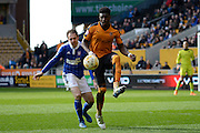Wolverhampton Wanderers defender Kortney Hause clears from Ipswich Town striker Brett Pitman during the Sky Bet Championship match between Wolverhampton Wanderers and Ipswich Town at Molineux, Wolverhampton, England on 2 April 2016. Photo by Alan Franklin.