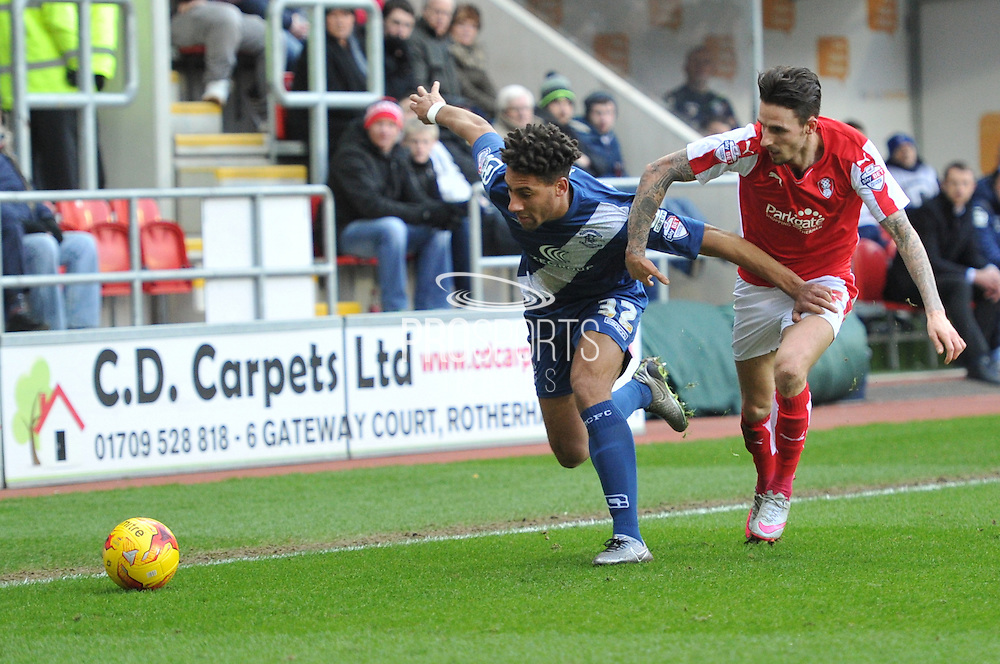 Andrew Shinnie of Birmingham city  and Matt Derbyshire of Rotherham United go the ball  during the Sky Bet Championship match between Rotherham United and Birmingham City at the New York Stadium, Rotherham, England on 13 February 2016. Photo by Ian Lyall.