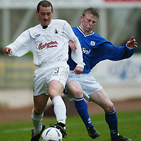 St Johnstone v Falkirk...03.04.04<br />Craig McPherson is tackled by Mark Baxter<br /><br />Picture by Graeme Hart.<br />Copyright Perthshire Picture Agency<br />Tel: 01738 623350  Mobile: 07990 594431