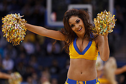 Mar 16, 2012; Oakland, CA, USA; A Golden State Warriors cheerleader performs during the fourth quarter against the Milwaukee Bucks at Oracle Arena. Milwaukee defeated Golden State 120-98. Mandatory Credit: Jason O. Watson-US PRESSWIRE