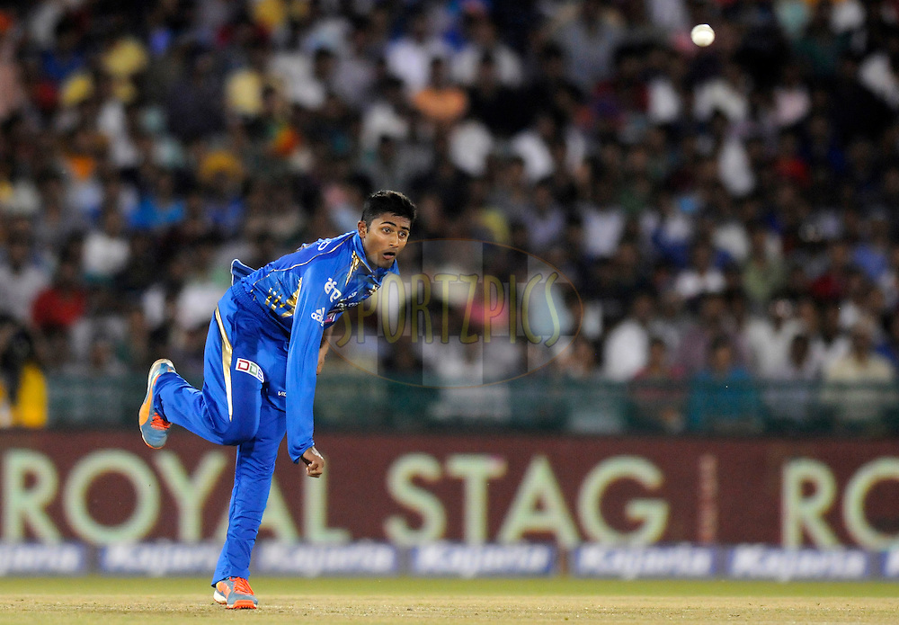 Shreyas Gopal of Mumbai Indians bowls during the qualifier 4 match of the Oppo Champions League Twenty20 between the Mumbai Indians and the Southern Express held at the Chhattisgarh International Cricket Stadium, Raipur, India on the 14th September 2014<br /> <br /> Photo by:  Pal Pillai / Sportzpics/ CLT20<br /> <br /> <br /> Image use is subject to the terms and conditions as laid out by the BCCI/ CLT20.  The terms and conditions can be downloaded here:<br /> <br /> http://sportzpics.photoshelter.com/gallery/CLT20-Image-Terms-and-Conditions-2014/G0000IfNJn535VPU/C0000QhhKadWcjYs