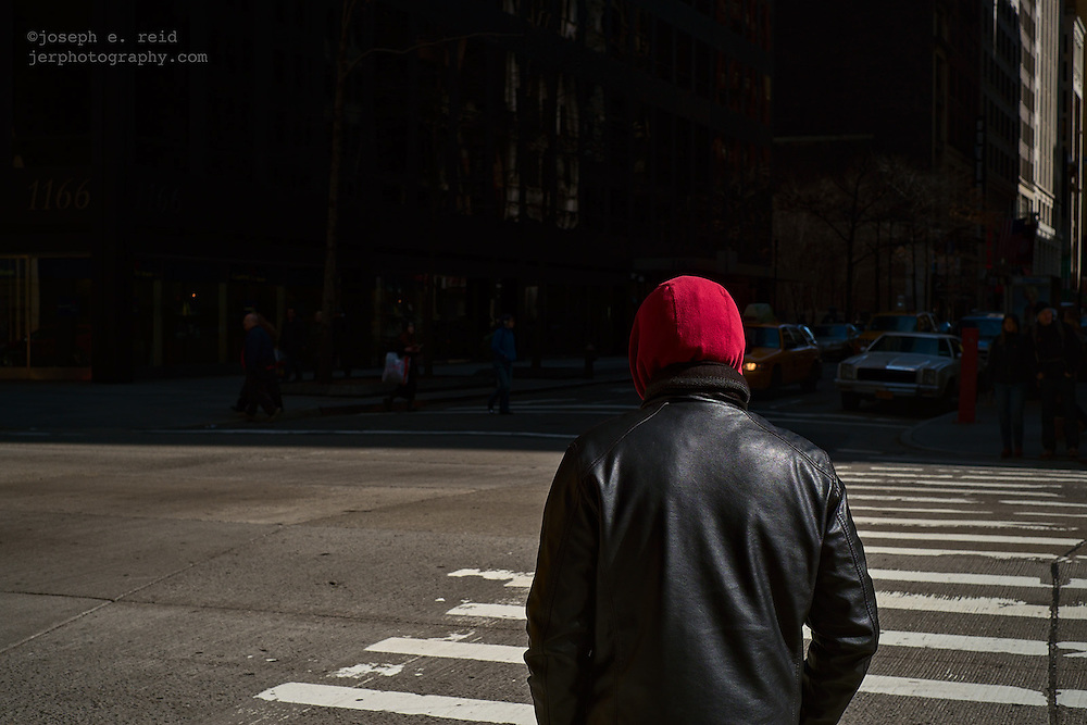 Man in red hood and black leather jacket, New York, NY, US