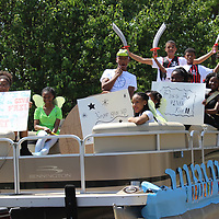 "Students don a pirate themed pontoon with the message of ""I Believe I Can Fly"" as far as their approach to taking state assessments."