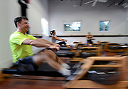 Rowing exercise machines in action at D-FINE Fitness in Albertson, New York.