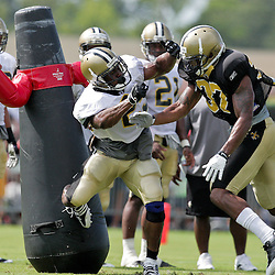 04 August 2009: Rookie safety Chip Vaughn (37) knocks back running back Reggie Bush (25) on a pass protection drill during New Orleans Saints training camp at the team's practice facility in Metairie, Louisiana.