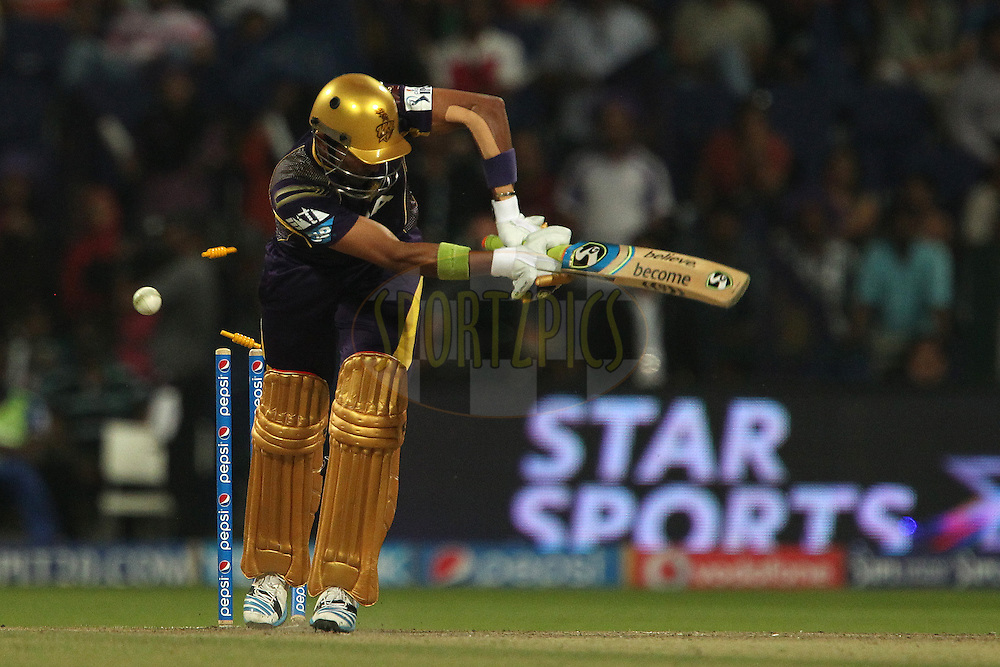 Robin Uthappa of the Kolkata Knight Riders has his stumps split by James Faulkner of the Rajatshan Royals during match 19 of the Pepsi Indian Premier League 2014 Season between The Kolkata Knight Riders and the Rajasthan Royals held at the Sheikh Zayed Stadium, Abu Dhabi, United Arab Emirates on the 29th April 2014<br /> <br /> Photo by Ron Gaunt / IPL / SPORTZPICS