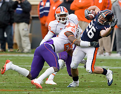 Clemson safety Michael Hamlin (25) tackles Virginia wide receiver Cary Koch (26) after a pass reception.  The Clemson Tigers defeated Virginia Cavaliers 13-3 in NCAA Division 1 football at Scott Stadium on the Grounds of the University of Virginia in Charlottesville, VA on November 22, 2008.