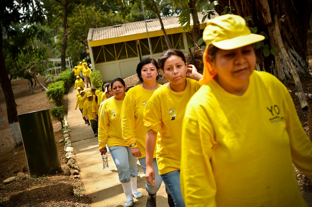 Female inmates walk to work at the Granja for women in El Salvador. The Granja, a newly launched project, is a working farm that teaches female inmates agriculture skills. In exchange for their work, inmates enjoy better living conditions and more personal freedoms than they had previously at Illopango prison in San Salvador, El Salvador.