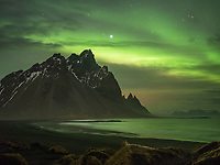 Northern lights over Stokksnes beach. Mount Vestrahorn in background. Southeast Iceland.