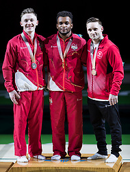 Left to right England's Nile Wilson (Silver), England's Courtney Tulloch (gold) and Canada's Scott Morgan (Bronze) with their medals after the Men's Rings at the Coomera Indoor Sports Centre during day four of the 2018 Commonwealth Games in the Gold Coast, Australia.