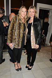 Left to right, ELIZA WINWOOD and AMBER WYLES at the Tatler Little Black Book Party held at Home House Private Member's Club, Portman Square, London supported by CARAT on 6th November 2014.