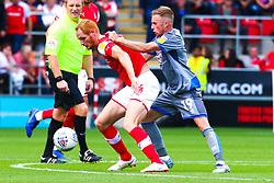 Joe Morrell of Lincoln City pulls the shirt of Shaun MacDonald of Rotherham United - Mandatory by-line: Ryan Crockett/JMP - 10/08/2019 - FOOTBALL - Aesseal New York Stadium - Rotherham, England - Rotherham United v Lincoln City - Sky Bet League One