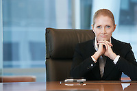Businesswoman sitting at conference table portrait