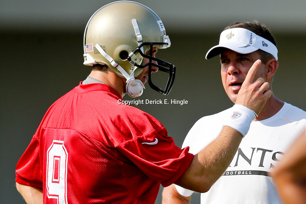 Jul 26, 2013; Metairie, LA, USA; New Orleans Saints quarterback Drew Brees (9) and head coach Sean Payton during first day of training camp practice at the team facility. Mandatory Credit: Derick E. Hingle-USA TODAY Sports