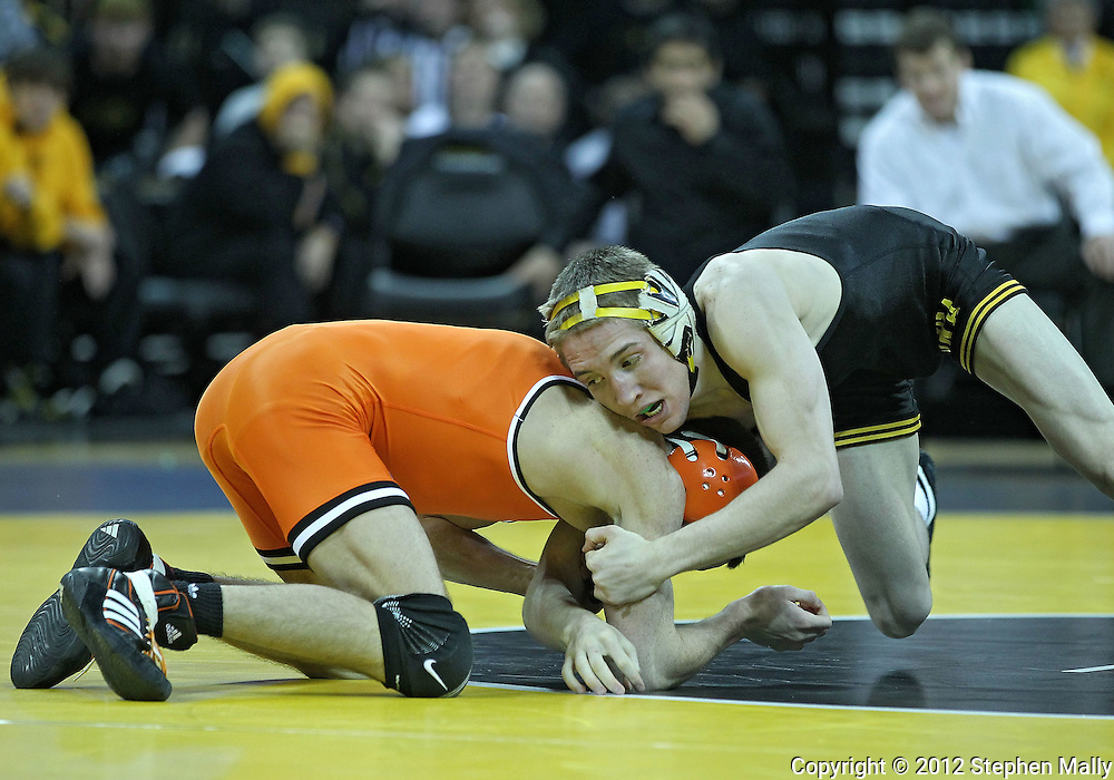January 07, 2011: Iowa's Matt McDonough tries to control Oklahoma State's Jon Morrison during the 125-pound bout in the NCAA wrestling dual between the Oklahoma State Cowboys and the Iowa Hawkeyes at Carver-Hawkeye Arena in Iowa City, Iowa on Saturday, January 7, 2012. McDonough won 14-4.