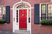 Elegant red front door of a home in the Beacon Hill historic district of the city of Boston, Massachusetts, USA