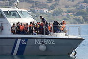 Oct. 15, 2015 - Lesbos Island, Greece - <br /> <br /> European Migrant Crisis<br /> <br /> Fatal Accident at sea caused at least nine deaths among migrants that in  thousands lands every day on the shores of the island of Lesbos from neighboring Turkey , distant only 4 nautical miles. Survived to the tragedy are arriving in the port of Molyvos.<br /> ©Exclusivepix Media