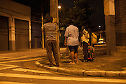 It's 0500 in the morning and Rosmery waits on the corner of her road for the school bus with her husband and two of her boys<br /> <br /> Missão Paz, an organisation that works in partnership with C&A Foundation, pays for children to attend Instituto Cristóvan School so that parents who are working in the textile industry can get on and work without worrying about looking after their childen at the same time.