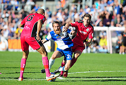 Bristol Rovers' Stuart Sinclair is held back by Dover Athletic's Tom Bonner - Photo mandatory by-line: Neil Brookman - Mobile: 07966 386802 - 04/10/2014 - SPORT - Football - Bristol - Memorial Stadium - Bristol Rovers v Dover - Vanarama Football Conference