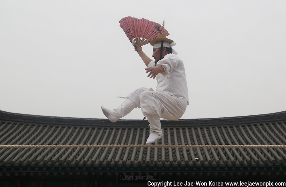 Kim Dae-gyun, tightrope walking master and the Important Intangible Cultural Property No. 58 of South Korea, performs in a village, Seoul, June 1, 2014. / Lee Jae-Won