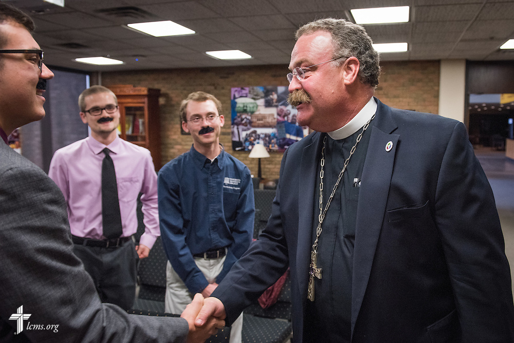 The Rev. Dr. Matthew C. Harrison, president of The Lutheran Church–Missouri Synod, meets Pre-Seminary Program students adorned with faux mustaches during a brief meeting on the university campus in River Forest, Ill., on Sunday, Oct. 12, 2014. LCMS Communications/Erik M. Lunsford