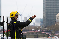 Westminster, London, March 29th 2017. One week after the terror attack on Westminster bridge, it is once again the scene of an emergency services operation as police, ambulance and fire crews search the river after a person jumped from the bridge. The person has not so far been recovered.<br /> PICTURED:  A firefighter directs his colleagues.<br /> CREDIT: ©Paul Davey<br /> FOR LICENCING CONTACT: Paul Davey +44 (0) 7966 016 296 paul@pauldaveycreative.co.uk
